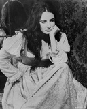 Elizabeth Taylor Leaning Chin on Hand in Classic Photo by Bob Penn