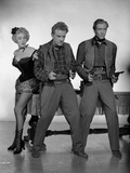 Marlene Dietrich standing with Two Men Holding Pistols Photo by  Movie Star News
