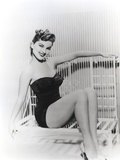 Debra Paget sitting on a Bench wearing Black Lingerie Photo by  Movie Star News