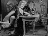 Marlene Dietrich sitting in Black Dress with Arm's Cross Photo by  Movie Star News