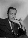 George Raft wearing Black Coat and Tie with Tobacco Pipe Photo by AL Schafer