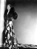 Alice Brady standing wearing a Dress with Fur Scarf Photo by  Movie Star News