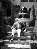 Fred Astaire Seated on Stairs in Black and White Photo by J Miehle