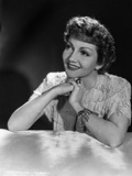 Claudette Colbert Leaning on Table with Black Background Photo by ER Richee
