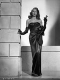 Rita Hayworth Posed in Black Dress with Cigarette Holder Photo by Robert Coburn