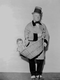 W C Fields in Suit and Top Hat Carrying a Basket with Baby Photo by  Movie Star News