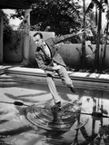 Fred Astaire standing in One Leg in Black and White Photo by J Miehle