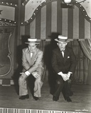 Bob Hope Seated with Man on Stage wearing Tuxedo with Hat Photo by  Movie Star News