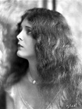 Mary Astro on a Necklace and Curly Long Hair Portrait Photo by  Movie Star News