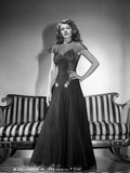 Rita Hayworth Posed in Black Gown with Hand on Waist Photo by  Hurrell