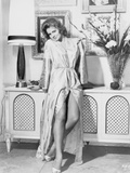 Angie Dickinson sitting on the Cabinet wearing a Silk Robe Photo by  Movie Star News