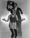 Al Jolson posed with a Woman in Front wearing a Suit Photo by  Movie Star News