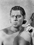 Johnny Weissmuller Holding a Knife in Black and White Photo by  Movie Star News