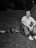 Fred Astaire Seated on Golf Bag in Black and White Photo by J Miehle