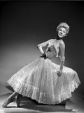 Vera Ellen on Printed Dress sitting and Leaning Portrait Photo by  Movie Star News