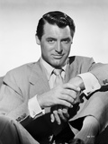 Cary Grant portrait in suit and tie holding hand Photo by E Bachrach