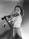Olivia DeHavilland Playing Violin in Black and White Photo by  Hurrell