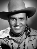 Gene Autry smiling in Striped Shirt and Cowboy Hat Photo by  Movie Star News