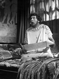Peter Ustinov Feeling Shocked in White Dress With Paper Photo by  Movie Star News