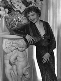 Claudette Colbert Leaning on Statue, wearing Black Dress Photo by ER Richee