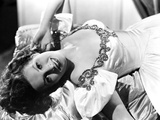 Maureen O'Hara Lying on a Couch wearing White Dress Photo by E Bachrach