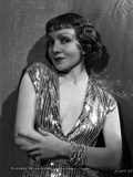 Claudette Colbert Posed in Glossy Dress with Arm's Cross Photo by  Hurrell