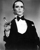 Joel Grey standing in Black Suit With Tabaco Photo by  Movie Star News