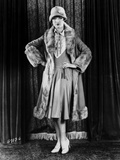 Louise Brooks standing in Fur Coat with Hands on Hips Photo by  Movie Star News