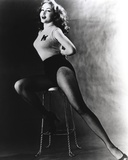 Julie Newmar Siting on Chair in Lingerie Black and White Photo by  Movie Star News