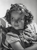 Shirley Temple wearing a Dress with Matching Hair Band Photo by  Hurrell