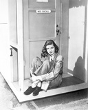 Lauren Bacall sitting with Legs Crossed in Black and White Photo by  Movie Star News