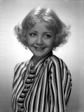Alice White smiling and wearing a Striped Long Sleeves Photo by  Movie Star News