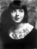 Colleen Moore on a Dark Top and smiling Portrait Photo by  Movie Star News