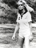 Heather Locklear standing in Sexy White Sportswear Photo by  Movie Star News