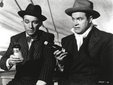Bob Hope Seated with Man, wearing Tuxedo with Hat Portrait Photo by  Movie Star News