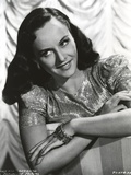Paulette Goddard Posed in Silk and Glittering Dress Photo by  Movie Star News