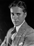 Charlie Chaplin in a Gray Suit and Tie with Signature Photo by Straus Peyton