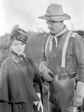 She Wore A Yellow Ribbon Man with Hat and Woman Talking Photo by  Movie Star News