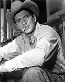 Rock Hudson Posed in Cowboy Outfit With Cigarette in Mouth Photo by  Movie Star News