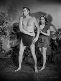 Johnny Weissmuller Defending a Woman in a Movie Scene Photo by  Movie Star News