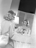 Gloria Grahame Looking in a Mirror in Backless Dress Photo by  Movie Star News