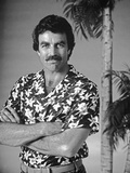 Magnum Pi standing in Floral Polo with Arm's Cross Photo by  Movie Star News
