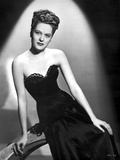 Alexis Smith sitting and wearing a Black Dress Photo af Movie Star News