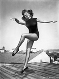 Rita Hayworth Skipping in a Black Swimming Suit Photo by  Movie Star News