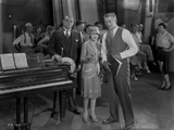 Al Jolson Discussing with His Group Near the Piano Photo by  Movie Star News