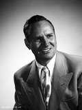 Gene Autry smiling in Suit with Gray Background Photo by  Movie Star News