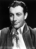 Robert Taylor smiling in White Shirt and Vest Photo by  Movie Star News