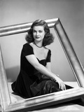 Joan Bennett sitting Pose with a Frame Portrait Photo by  Movie Star News