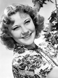 Una Merkel on an Printed Top and smiling Portrait Photo by  Movie Star News