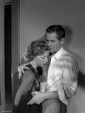 Human Desire Man in Long Sleeve Polo with Woman Photo by  Movie Star News